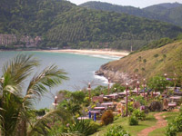 Viewpoint restaurant at Laem Promthep and in the distance is Nai Harn Beach